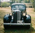 Classic Buick restored with black auto paint.